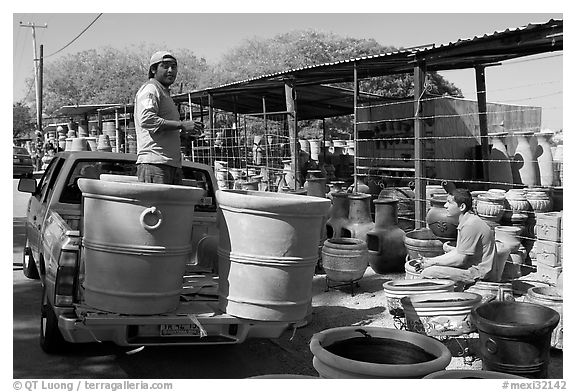 Pots being loaded on the back of a pick-up truck, Tonala. Jalisco, Mexico