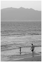 Man and child on the beach at sunset, Nuevo Vallarta, Nayarit. Jalisco, Mexico (black and white)