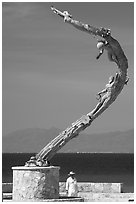Sculpture called Los Milenios by Fernando Banos on waterfront, Puerto Vallarta, Jalisco. Jalisco, Mexico (black and white)