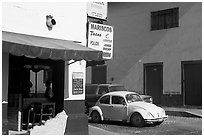 Restaurant at a street corner and Mexico made Wolskwagen bug, Puerto Vallarta, Jalisco. Jalisco, Mexico (black and white)