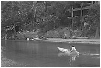 Woman using a canoe in a village,  Boca de Tomatlan, Jalisco. Jalisco, Mexico (black and white)