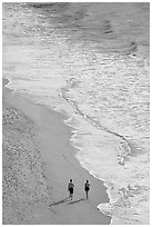 Couple walking on the beach seen from above, Puerto Vallarta, Jalisco. Jalisco, Mexico (black and white)
