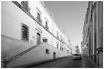 Car in street at dawn with Zacatecas Museum. Zacatecas, Mexico (black and white)