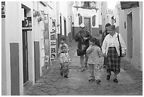 Family walking down an alley. Guanajuato, Mexico (black and white)