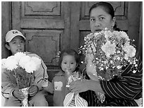 Woman with two children sitting in doorway. Guanajuato, Mexico (black and white)