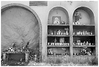 The exterior wall of a roadside chapel. Mexico (black and white)