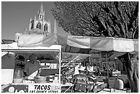 Taco stand on town plaza with cathedral in background. Mexico ( black and white)