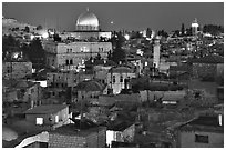 Old town roofs and Dome of the Rock by night. Jerusalem, Israel (black and white)