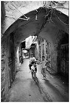 Two children under an archway, Hebron. West Bank, Occupied Territories (Israel) ( black and white)