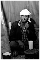 Bedouin man in a tent, Judean Desert. West Bank, Occupied Territories (Israel) (black and white)