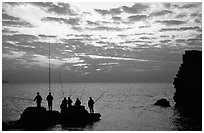 Fishermen standing on a rock, Akko (Acre). Israel (black and white)