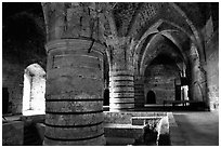 Huge columns in the Knights Hospitalliers quarters, Akko (Acre). Israel (black and white)