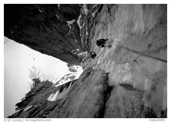 Climbers Frank and Alain climb thin ice in the Super-Couloir on Mt Blanc du Tacul, Mont-Blanc Range, Alps, France.