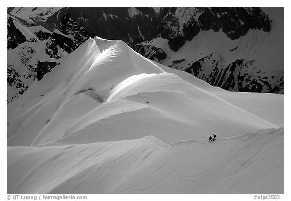Alpinists on the Aiguille du Midi ridge. Alps, France