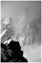 Alpinists on a buttress of Aiguille du Midi climbing the Cosmiques ridge. Alps, France (black and white)