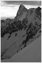 Alpinists climb Aiguille du Midi, France. (black and white)