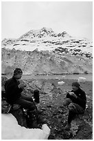 Eating breakfast in front of Lamplugh Glacier. Glacier Bay National Park, Alaska (black and white)