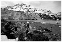 Eating in front of Lamplugh Glacier. Glacier Bay National Park, Alaska (black and white)