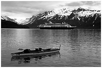 Kayak and cruise ship, East arm. Glacier Bay National Park, Alaska (black and white)
