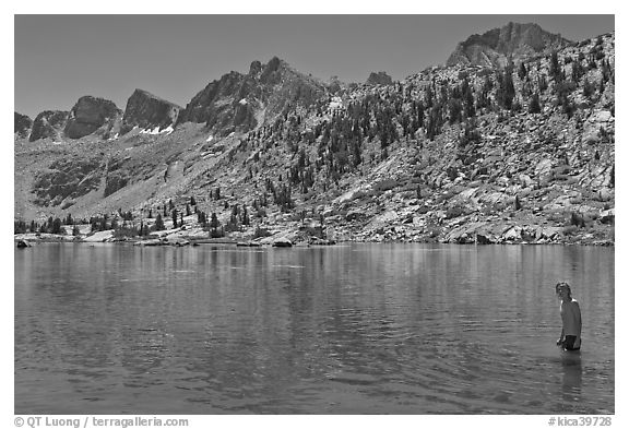 Young man in alpine lake, lower Dusy Basin. Kings Canyon National Park, California