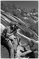 Men filming a waterfall, lower Dusy Basin. Kings Canyon National Park, California (black and white)