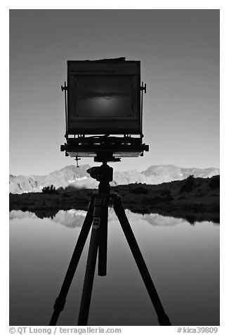 Large format camera with inverted image of mountain landscape on ground glass, Dusy Basin. Kings Canyon National Park, California