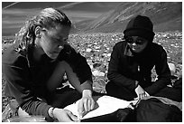 Women hikers consulting a map. Lake Clark National Park, Alaska (black and white)