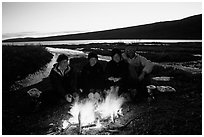 Warming toes on campfire next to Turquoise Lake. Lake Clark National Park, Alaska (black and white)