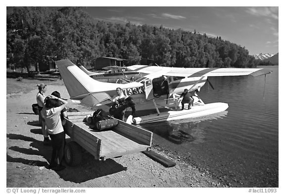Backpackes being unloaded from floatplane to a trailer in Port Alsworth. Lake Clark National Park, Alaska