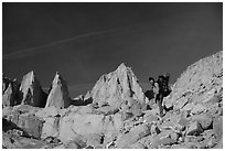 Woman with backpack hiking at the base of Mt Whitney. Sequoia National Park, California (black and white)