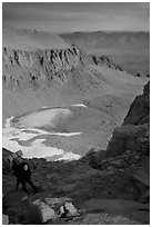 Woman on steep slope above frozen Iceberg Lake. Sequoia National Park, California (black and white)