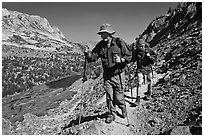 Father and son on trail above Long Lake, John Muir Wilderness. Kings Canyon National Park, California (black and white)