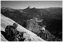 Climbing the Snake Dike route, Half-Dome. Yosemite National Park, California (black and white)