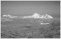 Mt Foraker and Mt Mc Kinley emerge from a sea of clouds. Denali National Park, Alaska, USA. (black and white)
