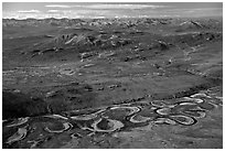 Aerial view of plain with meandering Alatna river and mountains. Gates of the Arctic National Park, Alaska, USA. (black and white)