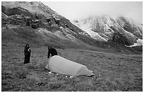 Backpackers camp at the base of the Arrigetch Peaks. Gates of the Arctic National Park, Alaska (black and white)
