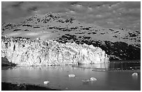 Lamplugh tidewater glacier and Mt Cooper. Glacier Bay National Park, Alaska, USA. (black and white)