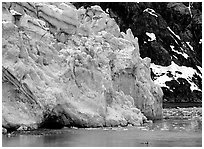 Kayaker dwarfed by Lamplugh glacier. Glacier Bay National Park ( black and white)
