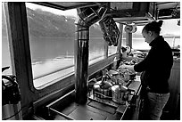 Chef preparing sadad in the main cabin of the Kahsteen. Glacier Bay National Park ( black and white)