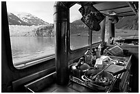 Breakfast potatoes in a small boat moored in front of glacier. Glacier Bay National Park, Alaska, USA. (black and white)