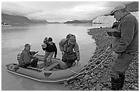Film crew lands near Margerie Glacier. Glacier Bay National Park, Alaska, USA. (black and white)