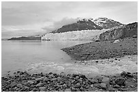 Stream flowing into Tarr Inlet, and Margerie Glacier. Glacier Bay National Park, Alaska, USA. (black and white)