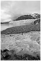 Stream flowing into Tarr Inlet, with Margerie Glacier in background. Glacier Bay National Park, Alaska, USA. (black and white)