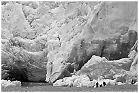 People at the base of Reid Glacier. Glacier Bay National Park, Alaska, USA. (black and white)