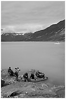 Film crew embarking on a skiff after shore excursion. Glacier Bay National Park, Alaska, USA. (black and white)