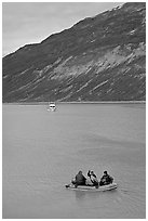 Skiff and tour boat in Reid Inlet. Glacier Bay National Park, Alaska, USA. (black and white)