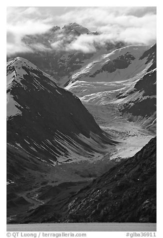 Topeka Glacier, peak and clouds, late afternoon. Glacier Bay National Park (black and white)