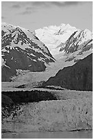 Margerie Glacier flowing from Mount Fairweather into the Tarr Inlet, sunrise. Glacier Bay National Park, Alaska, USA. (black and white)