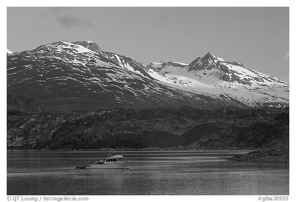 Small boat in Tarr Inlet, early morning. Glacier Bay National Park (black and white)