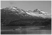 Small boat in Tarr Inlet, early morning. Glacier Bay National Park ( black and white)